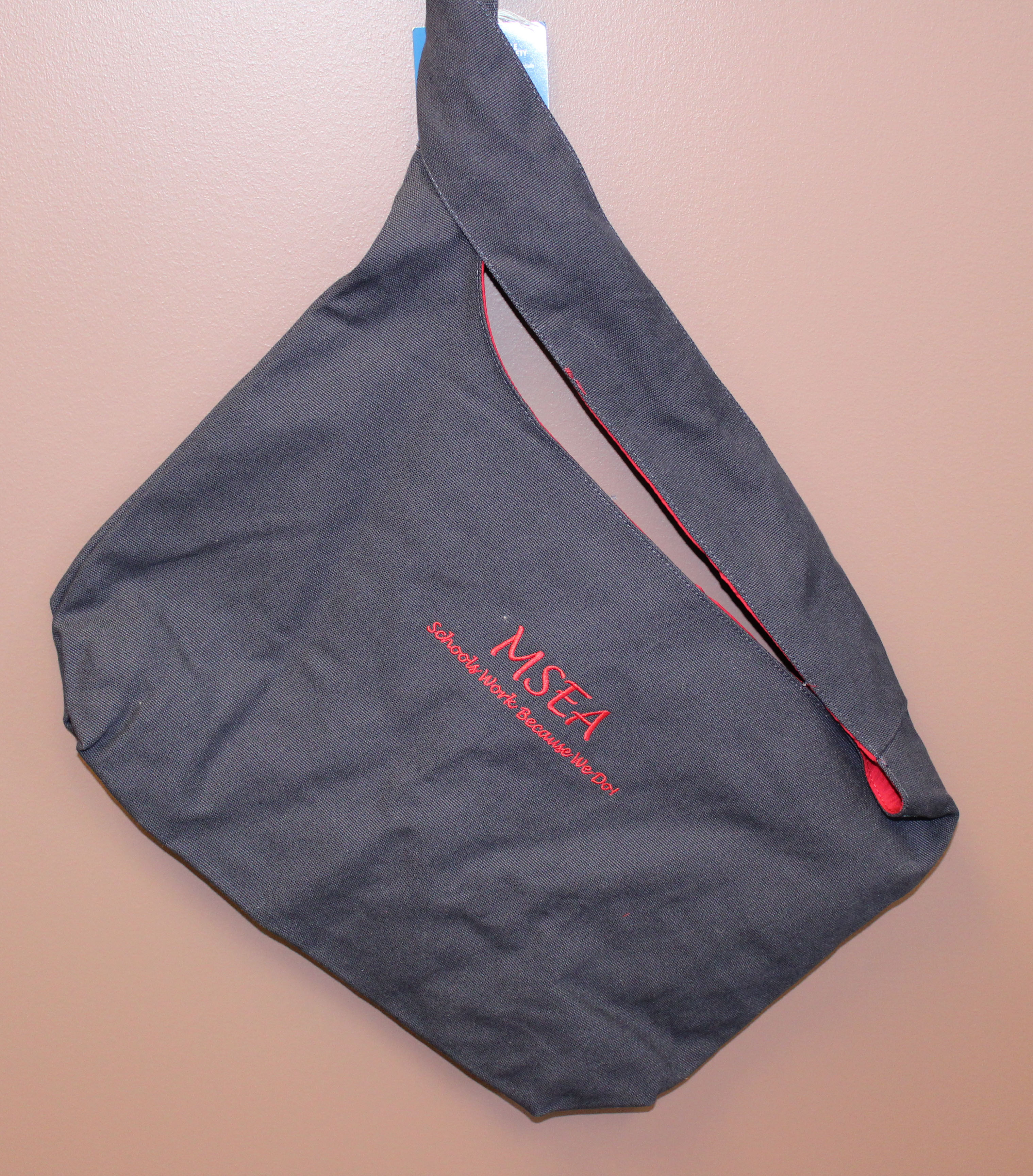 black MSEA messenger bag