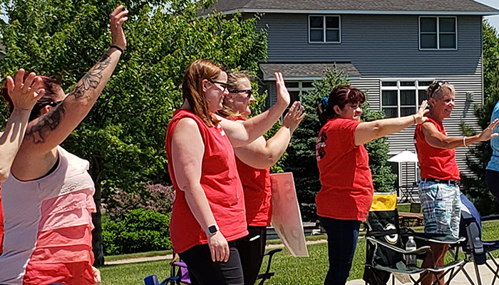 MSEA Shakopee Members Nicole Lightfoot, Brooke VonBank, Julia Perez and Anne Braun at the end of the school year parade.